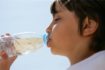 Boy drinking water in a bottle