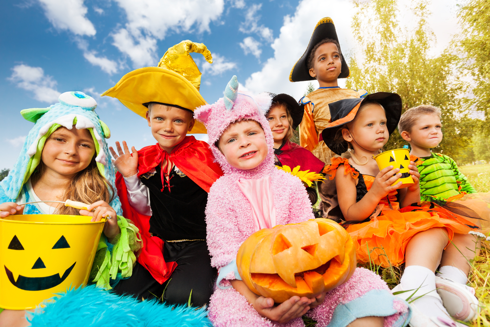 Children dressed up in halloween costumes ready to trick or treat