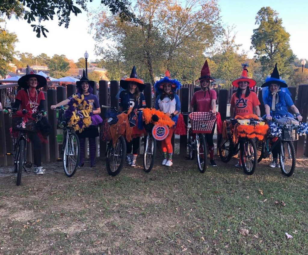 Women dressed as SEC witches with bikes