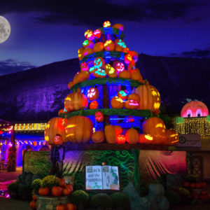 Glow in the dark pumpkin stack on a hay bale