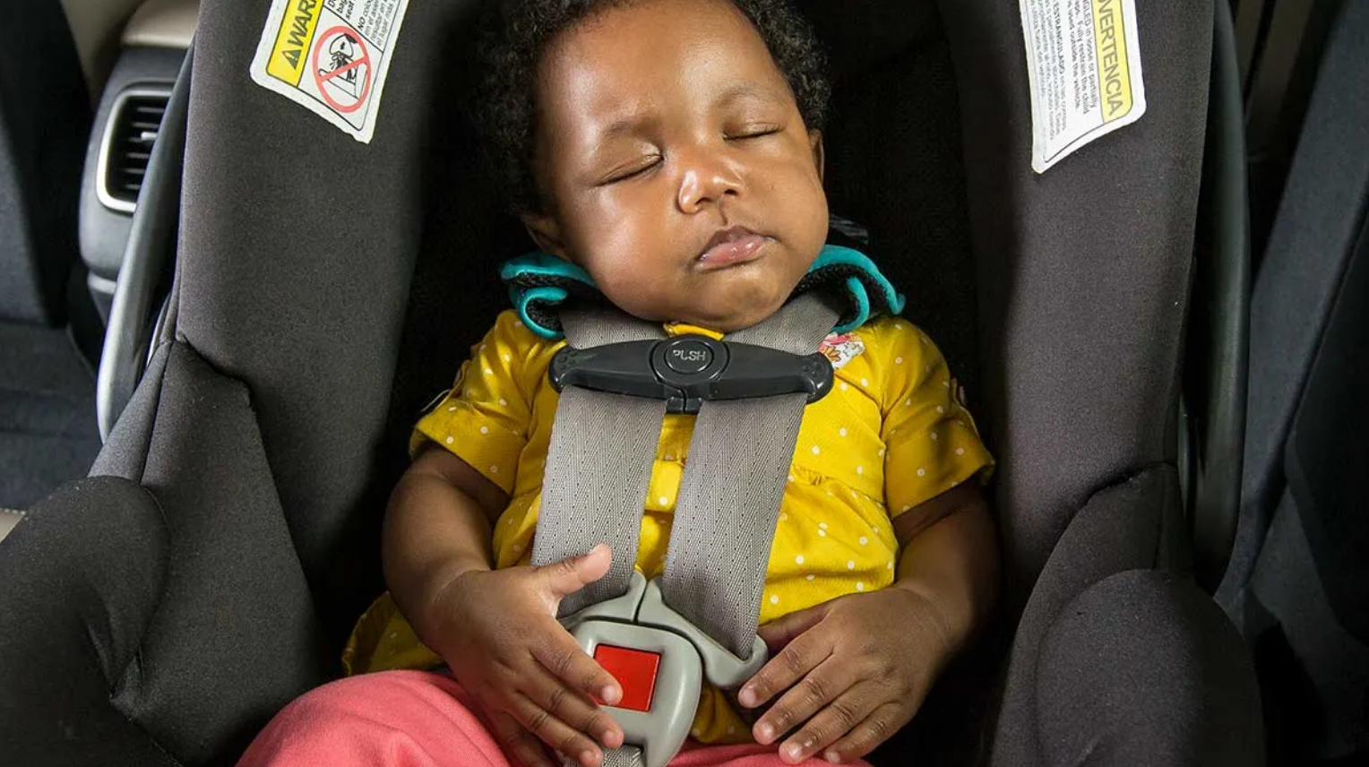 Baby sleeping in an infant car seat