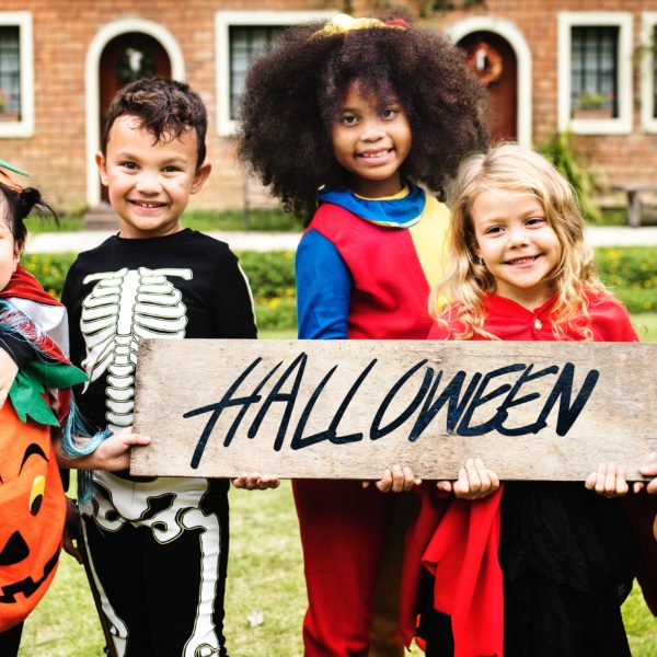 Children dressed up for trick or treating on halloween