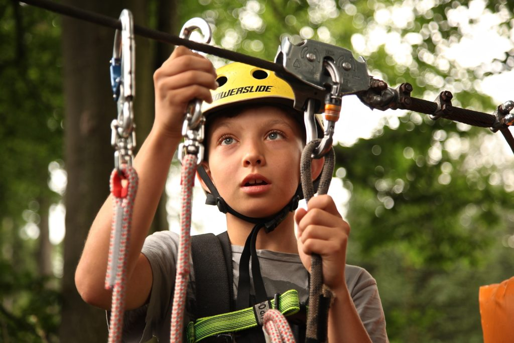 boy with caribiners, and climbing equipment